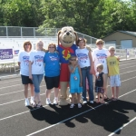 Dollar Dog leads the way for the NCACU team at the Houghton Lake Relay for Life walk.