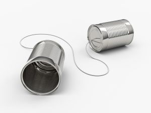 3D computer render of two tin cans and string on a white background.